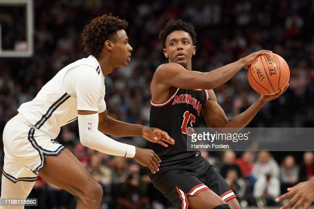 Bronny James of Sierra Canyon Trailblazers defends against Hercy Miller of Minnehaha Academy Red Hawks during the game at Target Center on January 04...