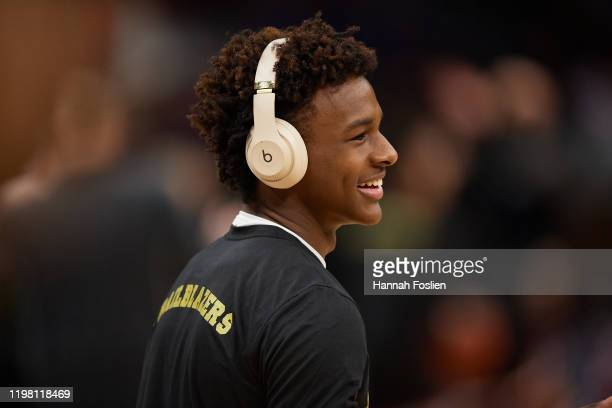 Bronny James of Sierra Canyon Trailblazers looks on during warmups before the game against the Minnehaha Academy Red Hawks at Target Center on...