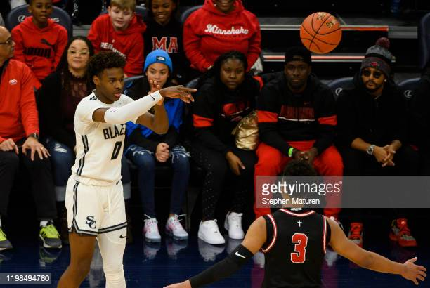 Bronny James of Sierra Canyon Trailblazers passes the ball in the first half of the game against the Minnehaha Academy Red Hawks at Target Center on...