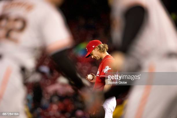 Bronson Arroyo of the Cincinnati Reds looks down after giving up a home run against the Giants to Christian Arroyo who receives a handshake from the...