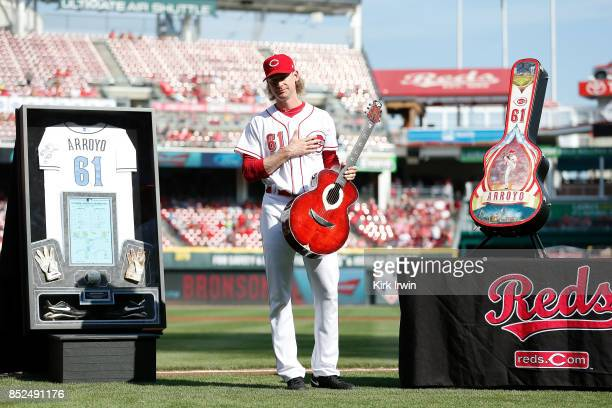Bronson Arroyo of the Cincinnati Reds shows his appreciation after being given a shadow box made with his jersey batting gloves cleats ball and score...