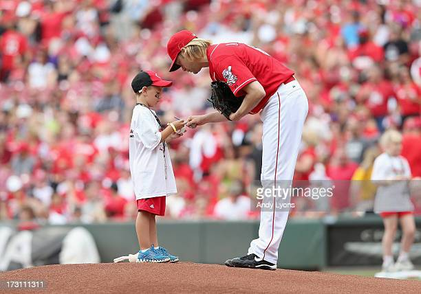Bronson Arroyo of the Cincinnati Reds signs an autograph before the start of the game against the Seattle Mariners at Great American Ball Park on...