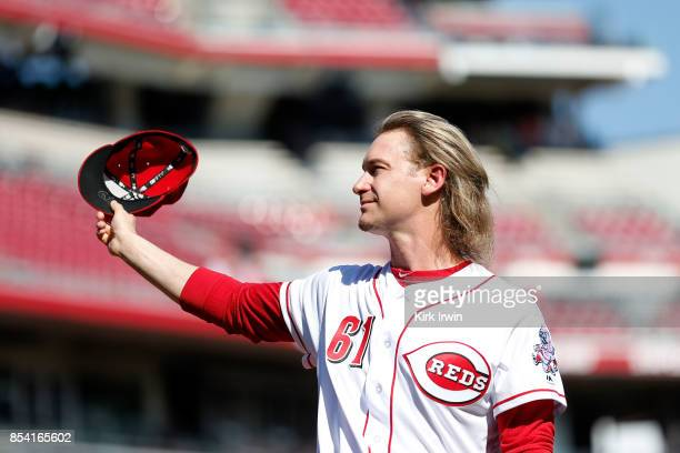Bronson Arroyo of the Cincinnati Reds waves to the fans as he is honored for his career prior to the start of the game against the Boston Red Sox at...