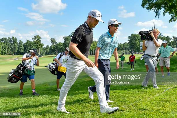 Bronson Burgoon and Michael Kim walk off the 17th hole during the final round of the John Deere Classic on July 15 2018 at the TPC Deere Run in...