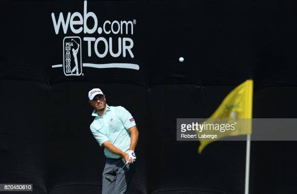 Bronson Burgoon makes a shot after taking a drop on the 18th green during round two of the Webcom Tour Pinnacle Bank Championship on July 21 2017 at...
