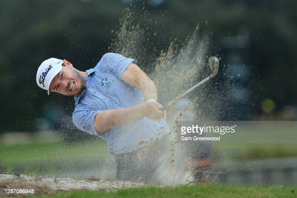 Bronson Burgoon of the United States plays a shot from a bunker on the 13th hole during the final round of The RSM Classic at the Seaside Course at...