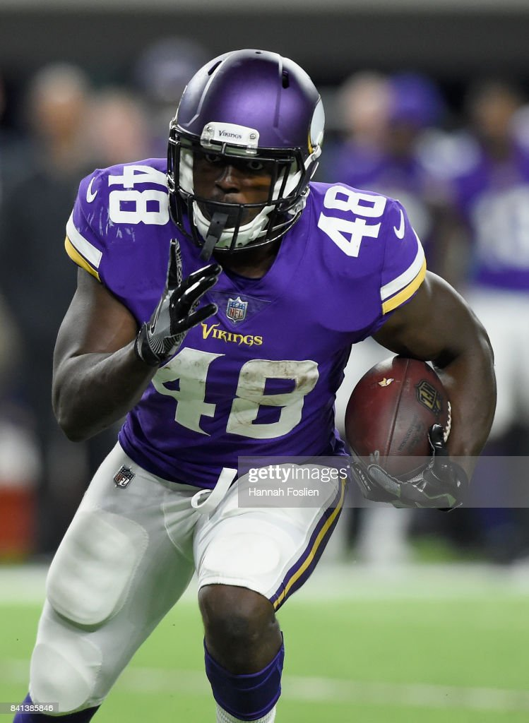 Bronson Hill #48 of the Minnesota Vikings carries the ball against the Miami Dolphins during the fourth quarter in the preseason game on August 31, 2017 at U.S. Bank Stadium in Minneapolis, Minnesota. The Dolphins defeated the Vikings 30-9.