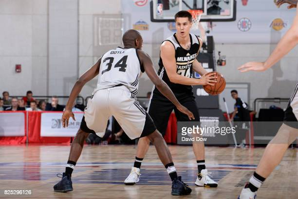 Bronson Koenig of the Milwaukee Bucks handles the ball during the game against Milton Doyle of the Brooklyn Nets during the 2017 Las Vegas Summer...