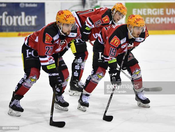 Bronson Maschmeyer and Marian Dejdar of Bremerhaven look dejected during the fourth leg quater final playoff match between Fischtown Pinguins and EHC...