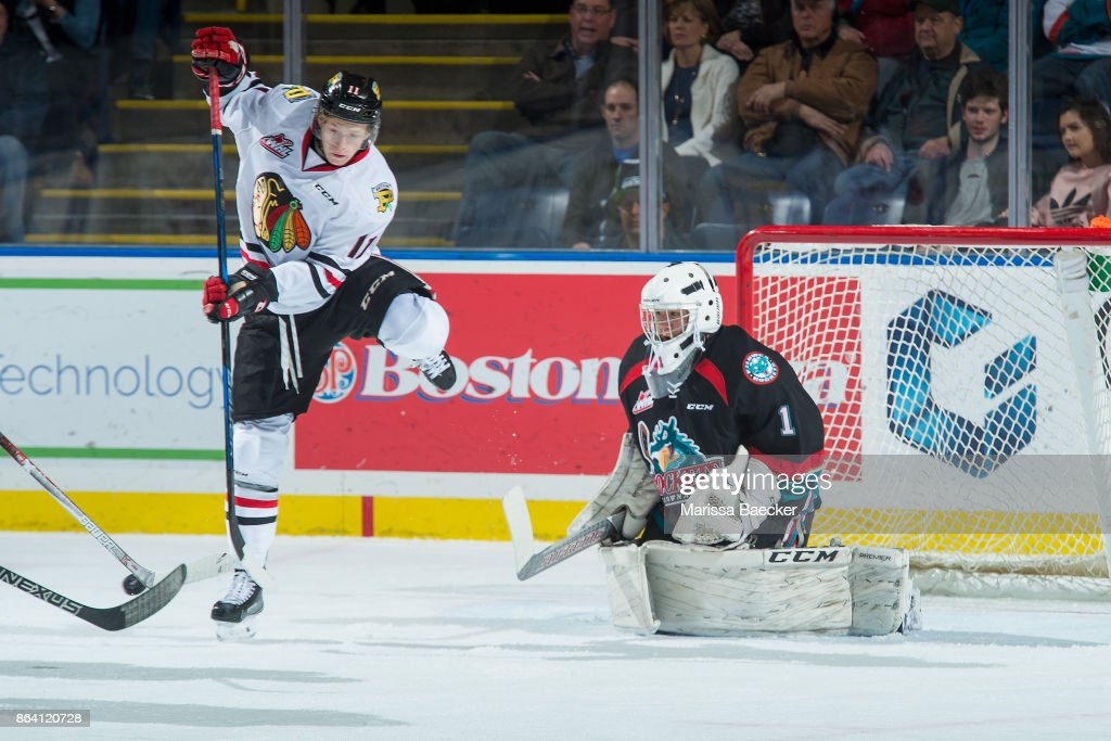 Bronson Sharp #11 of the Portland Winterhawks jumps to clear a shot on net of James Porter #1 of the Kelowna Rockets during first period at Prospera Place on October 20, 2017 in Kelowna, Canada.