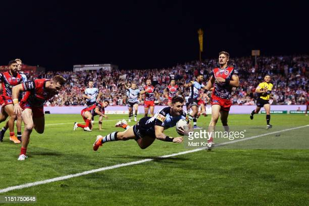 Bronson Xerri of the Sharks scores a try during the round 11 NRL match between the St George Illawarra Dragons and the Cronulla Sharks at WIN Jubilee...