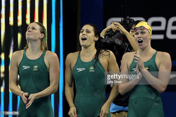 Bronte Barratt Blair Evans and Angie Bainbridge of Australia cheer on Kylie Palmer as they compete in the Women's 4x200m Freestyle final during Day...