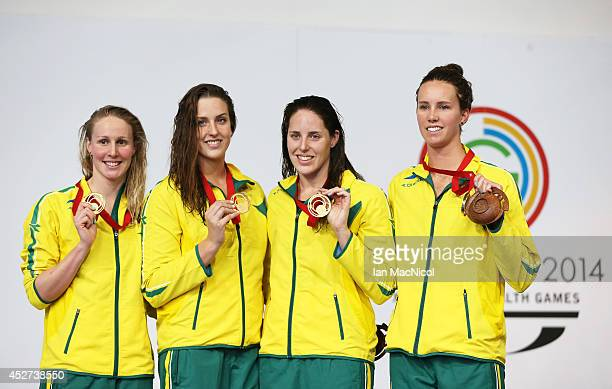 Bronte Barratt Brittany Elmslie Alicia Coutts and Emma McKeon of Australia pose after winning Gold in the Women's 4x200m Freestyle Final at Tollcross...