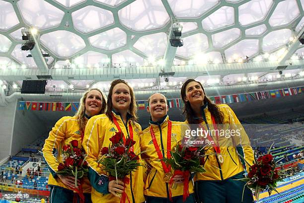 Bronte Barratt, Kylie Palmer, Linda Mackenzie and Stephanie Rice of Australia pose with the gold medal after the medal ceremony for the Women's 4 x...