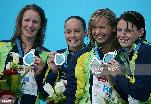 Bronte Barratt Linda MacKenzie Lisbeth Lenton and Shayne Reese of Australia smile after receiving the silver medal in the 4x200 meter Freestyle relay...