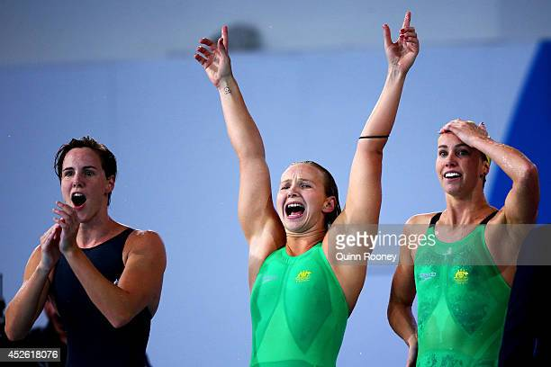 Bronte Campbell Melanie Schlanger and Emma McKeon of Australia cheer on the way to winning the gold medal in the Women's 4 x 100m Freestyle Relay...