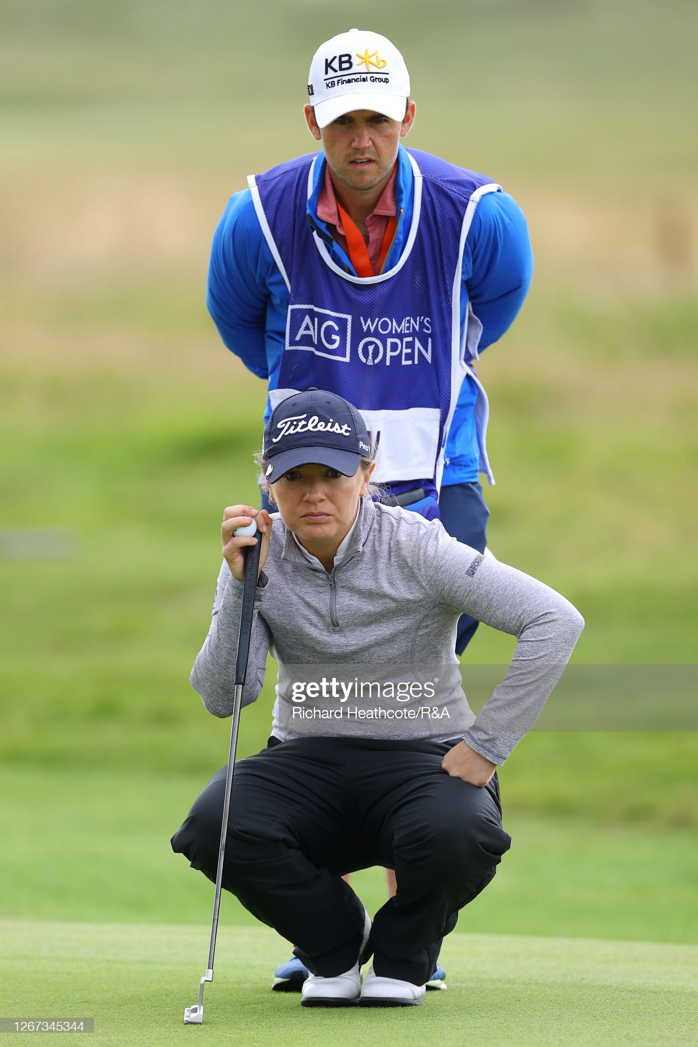 https://media.gettyimages.com/photos/brontelaw-of-england-lines-up-a-putt-on-the-16th-green-with-caddie-picture-id1267345344?s=2048x2048