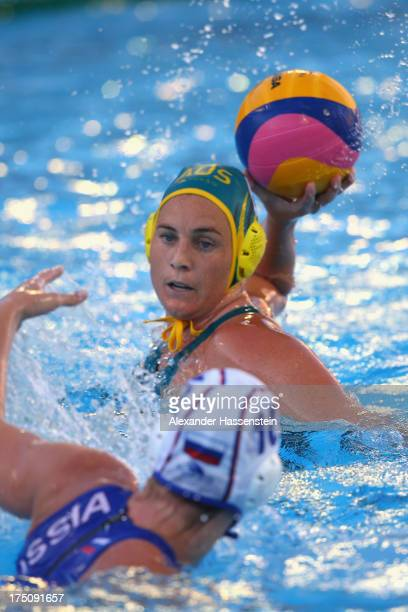 Bronwen Knox of Australia in action against Olga Beliaeva of Russia during the Women's Water Polo Semifinal Round between Russia and Australia during...