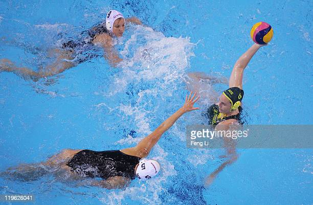 Bronwen Knox of Australia is challenged by Gabriella Szucs of Hungary in the Women's Water Polo second preliminary round match between Hungary and...
