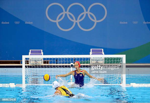 Bronwen Knox of Australia shoots against goalkeeper Orsolya Kaso of Hungary during a shootout in their Women's Water Polo quarterfinal match at the...