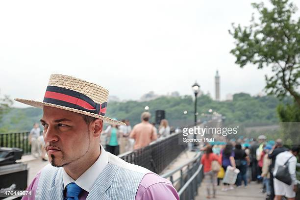 Bronx Ambassador Baron Ambrosia pause as pedestrians walk over the High Bridge the city's oldest standing bridge for the first time since it was...