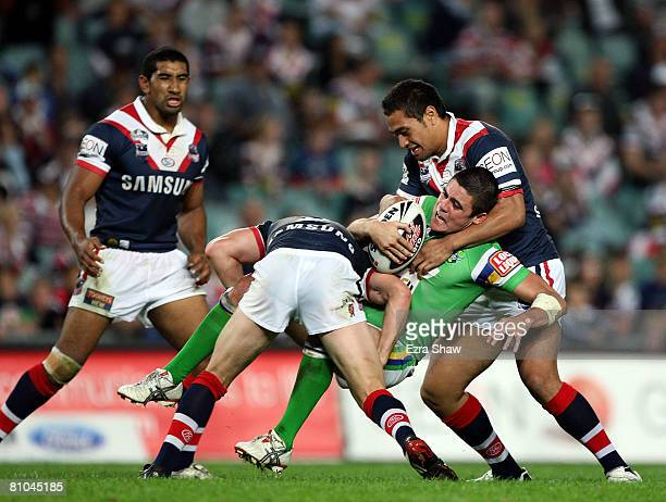Bronx Goodwin of the Raiders is tackled by the Roosters during the round nine NRL match between the Sydney Roosters and the Canberra Raiders at the...