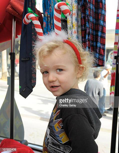 Bronx Mowgli Wentz poses for a family portrait onboard the Old Navy Awkward Holiday Photo Mobile at Old Navy on the 3rd Street Promenade on December...