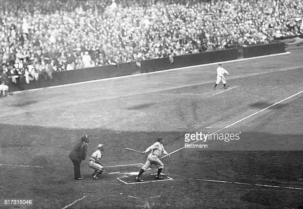 Bronx, New York: Babe Ruth hitting a double in the first inning of the first game of the World Series today. Ruth scored later when Gehrig doubled.
