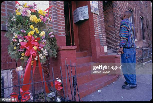 Flowers and posters adorn the hallway where Adadou Diallo was shot 41 times by NYC police