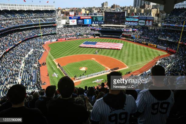 New York Yankees and the Baltimore Orioles line up for opening day ceremonies at the start of the Yankees home opener at Yankee Stadium in the Bronx,...