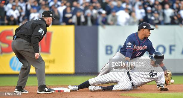 New York Yankees second baseman DJ LeMahieu is safe at 2nd base as Minnesota Twins shortstop Jorge Polanco drops the ball on the double in the 1st...