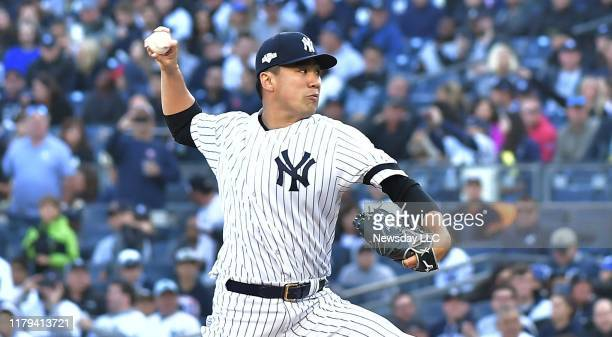 New York Yankees starting pitcher Masahiro Tanaka delivers a pitch in the 1st inning against Minnesota Twins at Game 2 of the American League...