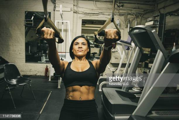 Officer Julissa Camacho works out at the 44th precinct gym in the Bronx, New York on April 3, 2019. Camacho is training to participate in her first...