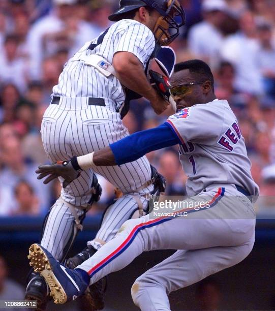 Toronto Blue Jay's Tony Fernandez is safe at the plate in the 5th as New York Yankee Jorge Posada takes the late throw September 12 1998 at Yankee...