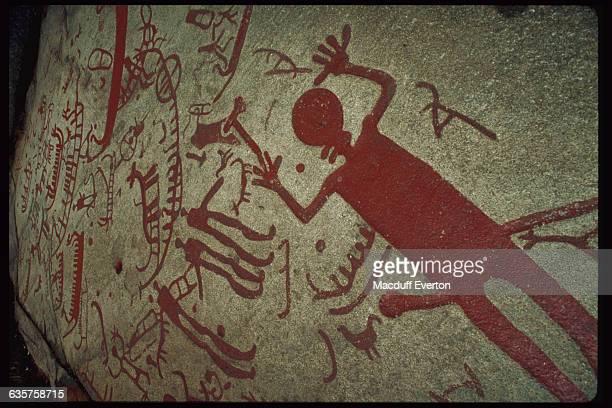 Bronze Age petroglyphs depict men animals boats and hunting scenes Bohuslan Sweden