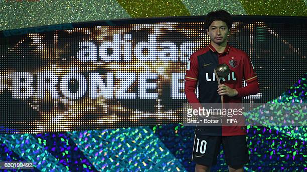 Bronze boot winner Gaku Shibasaki of Kashima Antlers poses for photos after the FIFA Club World Cup final match between Real Madrid and Kashima...