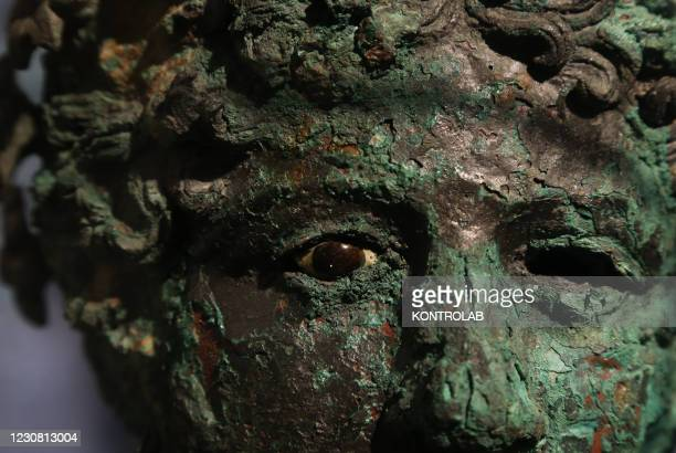 Bronze bust depicting Dionisus is displayed in the Antiquarium, a new museum venue in the Pompeii archaeological site with a permanent display of...
