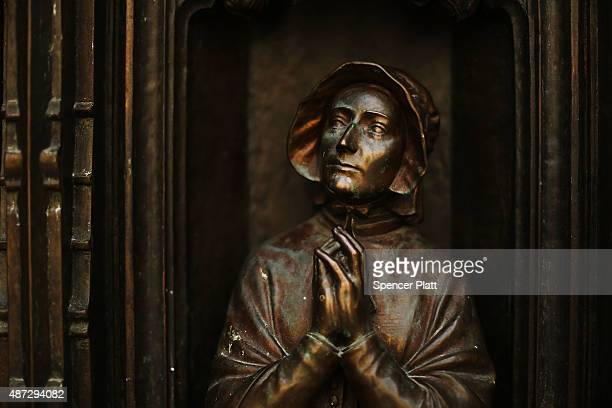 A bronze bust is viewed on a door at St Patrick's Cathedral the seat of the Roman Catholic Archdiocese of New York on September 8 2015 in New York...