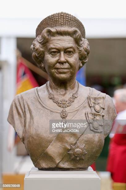 A bronze bust of Queen Elizabeth II is pictured as the Queen visits the Honourable Artillery Company in London on June 1 2016 The engagement marks...