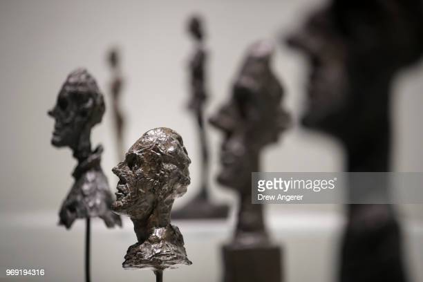 Bronze busts are displayed at a retrospective exhibition of work by Swiss sculptor and artist Alberto Giacometti at the Guggenheim Museum June 7 2018...