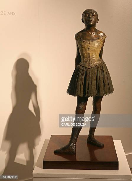 A bronze cast sculpture entitled 'Petite danseuse de quatorze ans' by French artist Edgar Degas is displayed at Sotheby's auction house in London on...