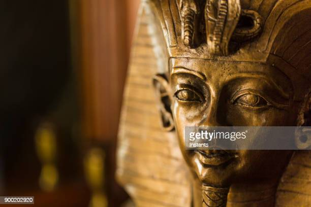 Bronze color bust of Egyptian King Tutankhamun made with plaster.