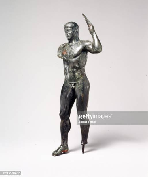 Bronze diskos thrower, Classical, ca. 480-460 B.C, Greek, Bronze, H. 9 5/8 in. , This superlative bronze embodies the highest achievements of the...