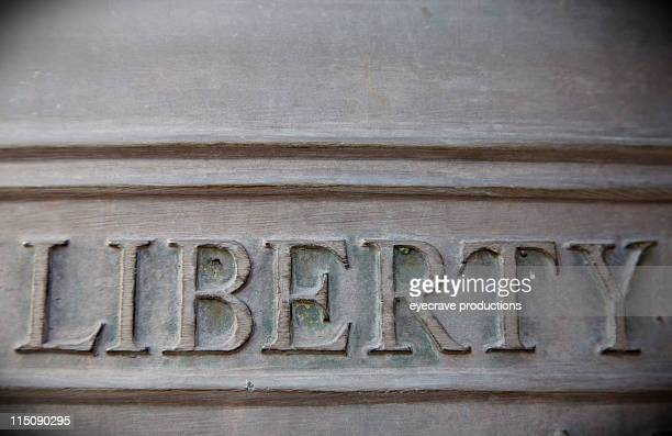 bronze embossed liberty bell - liberty bell stock pictures, royalty-free photos & images