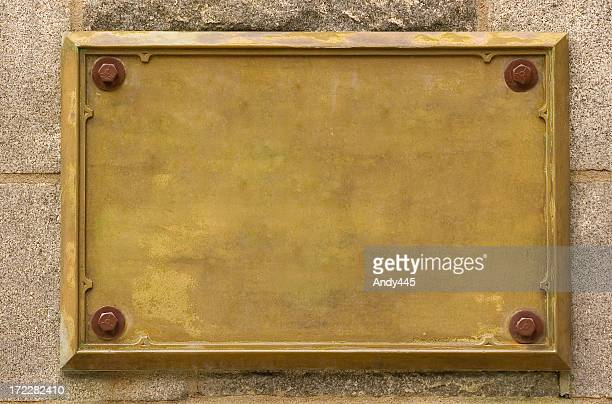 bronze empty plaque fixed on wall - bronze medalist stock pictures, royalty-free photos & images