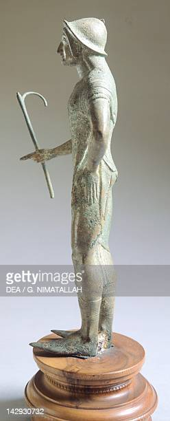 Bronze figure in a toga making an offering, side view, from Isola di Fano . Etruscan Civilization, ca 480 BC. Florence, Museo Archeologico Nazionale