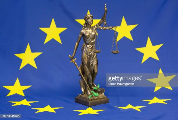 Bronze figure of Justitia Roman goddess of justice and of legal system The picture shows Justitia with the European flag Symbol photo on the topics...