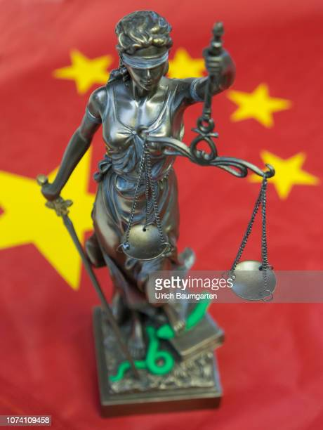 Bronze figure of Justitia Roman goddess of justice and of legal system The picture shows Justitia with the flag of the Peoples Republic of Chine...