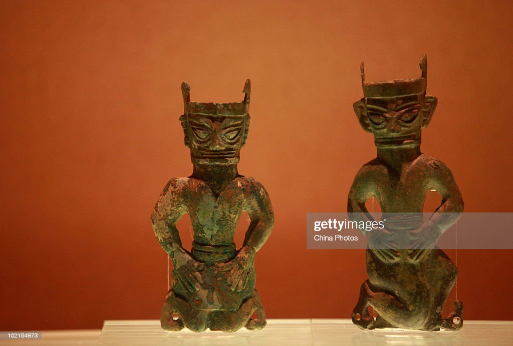 Bronze figures are displayed at the Sanxingdui Museum on June 14, 2010 in Guanghan of Sichuan Province, China. Sanxingdui Museum is located in Northeast of Sanxingdu archeological site which believed to be the capital of ancient Shu, with more than 3,000-year history.