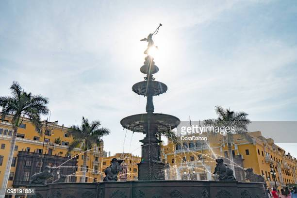 bronze fountain and cathedral, plaza de armas, lima - lima animal stock pictures, royalty-free photos & images
